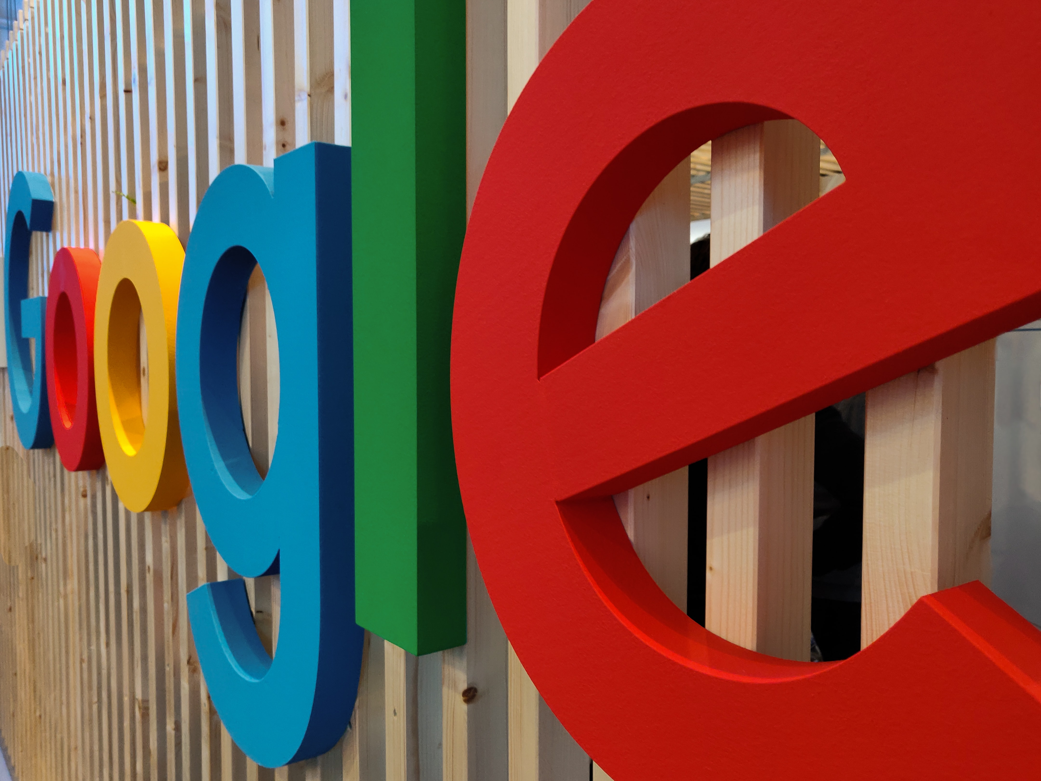 Google Colorful Logo on Wood Background