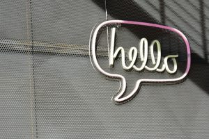 Hello Sign on Metal Background